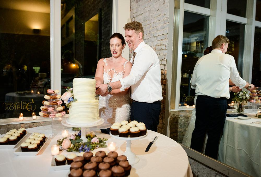 Bride and Groom cutting their wedding cake, 5Eleven Palafox, Classic Pensacola Wedding, Lazzat Photography, Florida Wedding Photographer