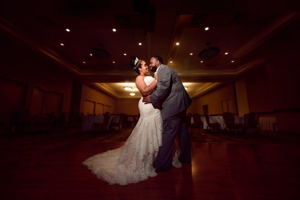 Bride and Groom posing in the dark ballroom, Blue and Pink Wedding, The Soundside Club, Elegant Ballroom Wedding, Lazzat Photography, Florida Wedding Photography