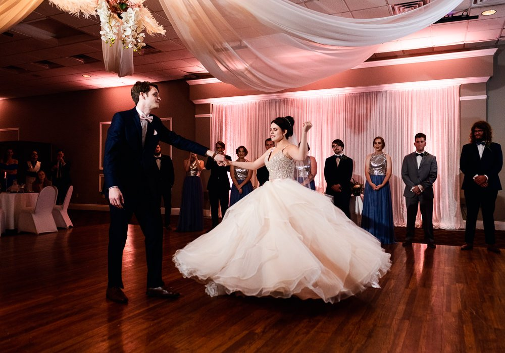 Groom spinning Bride during first dance, Romantic Catholic Wedding, Pensacola Florida Wedding Photographer, Lazzat Photography