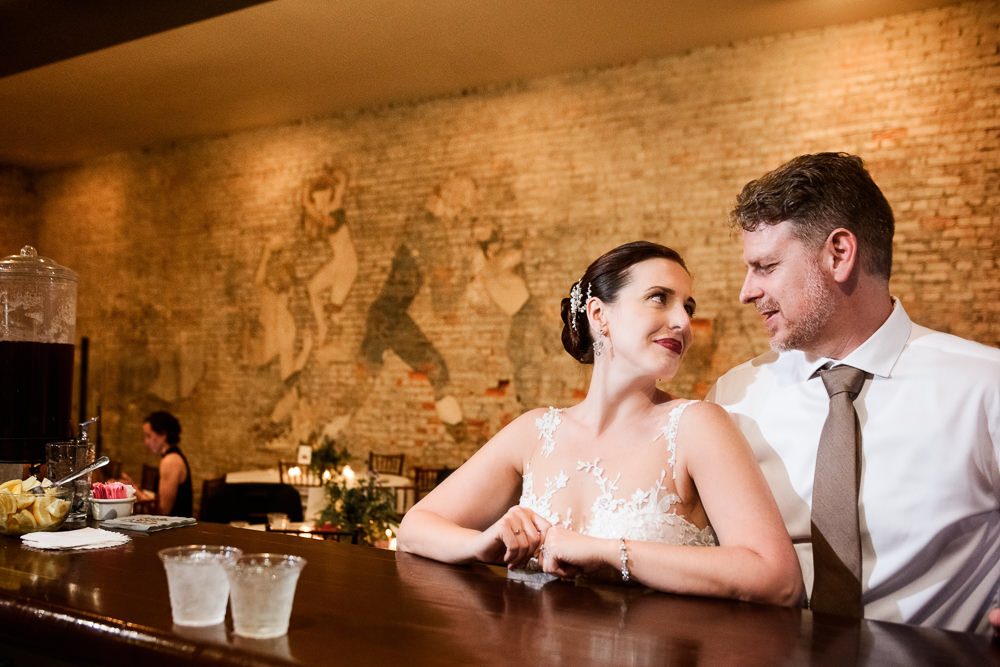 Bride and Groom at the bar, 5Eleven Palafox, Classic Pensacola Wedding, Lazzat Photography, Florida Wedding Photographer