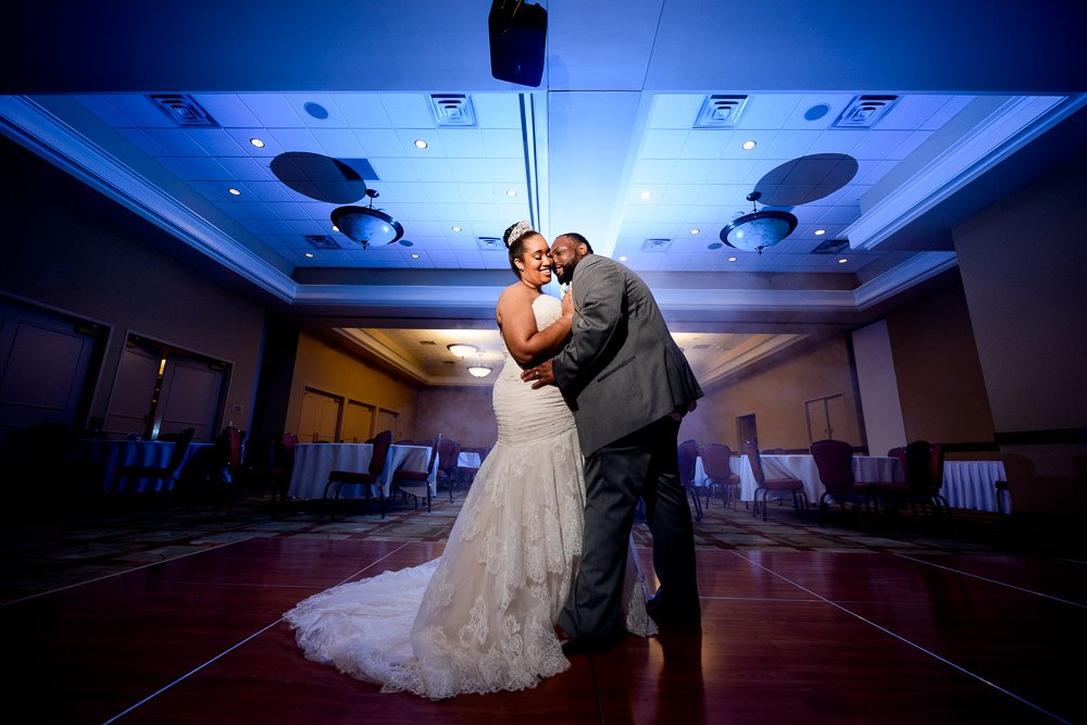 Bride and Groom posing in the ballroom after their wedding, Blue and Pink Wedding, The Soundside Club, Elegant Ballroom Wedding, Lazzat Photography, Florida Wedding Photography