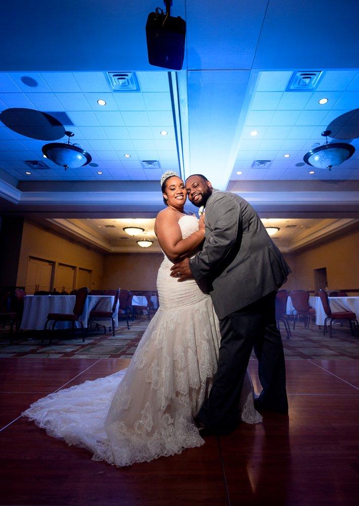 Bride and Groom posing after their wedding, Blue and Pink Wedding, The Soundside Club, Elegant Ballroom Wedding, Lazzat Photography, Florida Wedding Photography