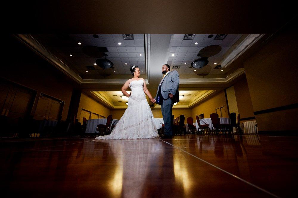 Bride and Groom posing in the ballroom, Blue and Pink Wedding, The Soundside Club, Elegant Ballroom Wedding, Lazzat Photography, Florida Wedding Photography