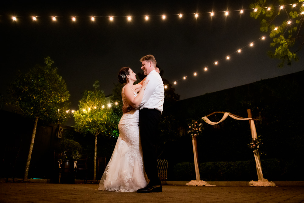Bride and Groom hugging in the courtyard, 5Eleven Palafox, Classic Pensacola Wedding, Lazzat Photography, Florida Wedding Photographer