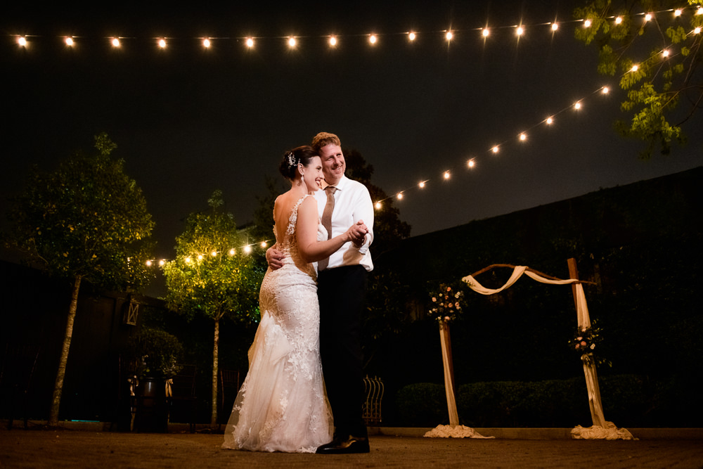 Bride and Groom dancing in the courtyard, Classic Pensacola Wedding, 5Eleven Palafox, Lazzat Photography, Florida Wedding Photographer