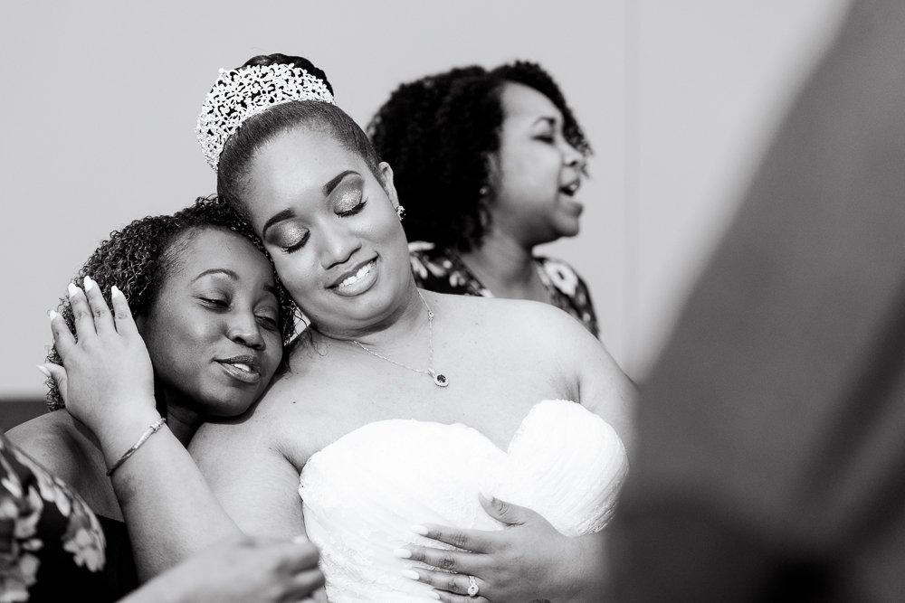 Bride hugging her sorority sister, Zeta Phi Beta Sorority Incorporated, black and white, Blue and Pink Wedding, The Soundside Club, Elegant Ballroom Wedding, Lazzat Photography, Florida Wedding Photography