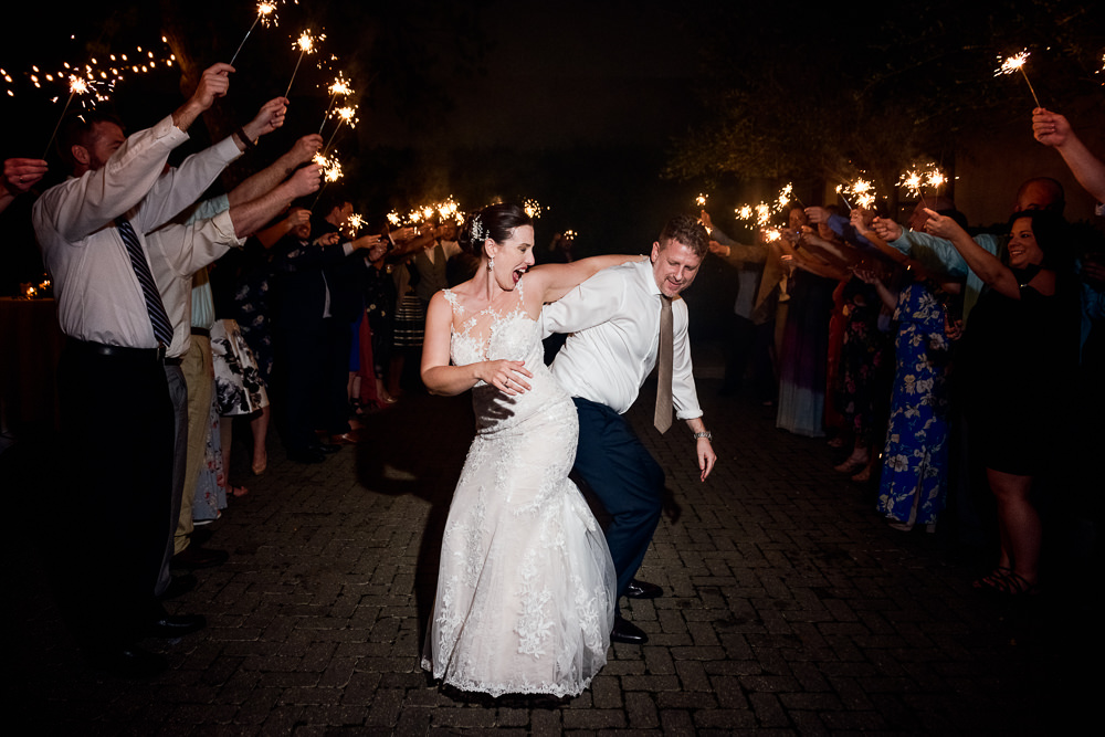 Bride and Groom bumping butts during their sparkler exit, 5Eleven Palafox, Classic Pensacola Wedding, Lazzat Photography, Florida Wedding Photographer