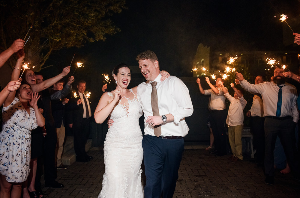 Bride and Groom laughing during their sparkler exit, Classic Pensacola Wedding, 5Eleven Palafox, Lazzat Photography, Florida Wedding Photographer
