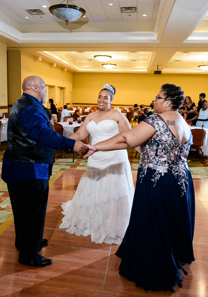 Bride dancing with her parents, Blue and Pink Wedding, The Soundside Club, Elegant Ballroom Wedding, Lazzat Photography, Florida Wedding Photography