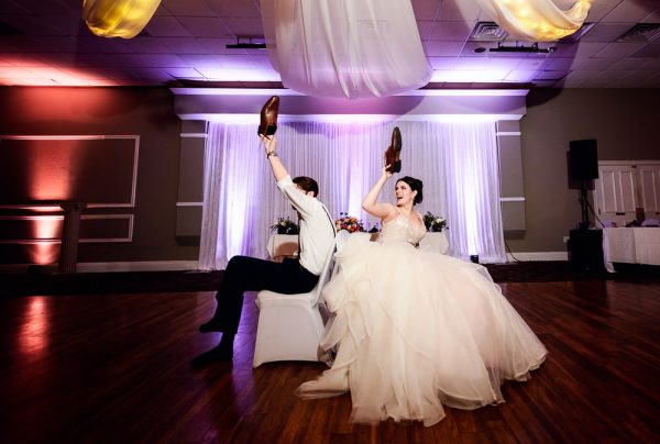 Bride and Groom playing the shoe game, Romantic Catholic Wedding, Pensacola Florida Wedding Photographer, Lazzat Photography