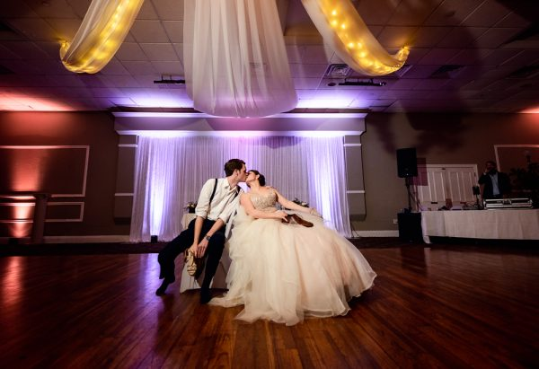 Bride and Groom kissing after their shoe game, Romantic Catholic Wedding, Pensacola Florida Wedding Photographer, Lazzat Photography