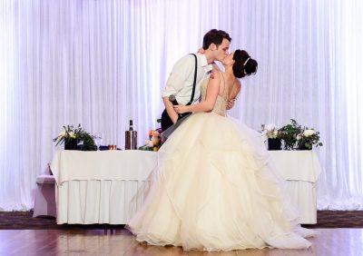 Bride and Groom kissing at the reception, Romantic Catholic Wedding, Pensacola Florida Wedding Photographer, Lazzat Photography