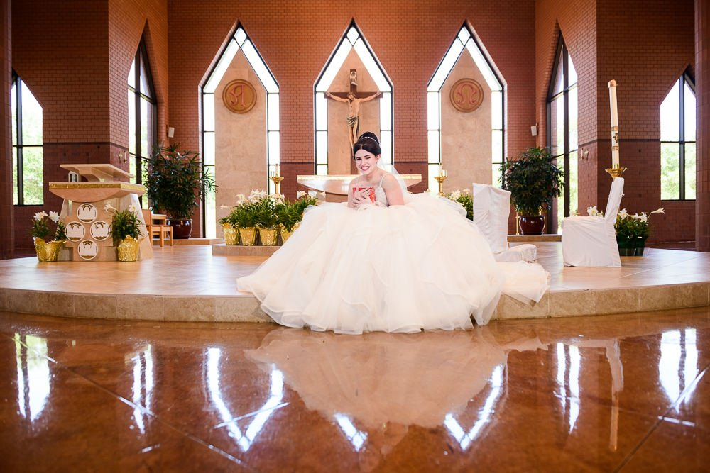 Bride hugging her gift from her Groom, Romantic Catholic Wedding, Pensacola Florida Wedding Photographer, Lazzat Photography