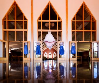 Bride's ballgown hanging with blue bridesmaids dresses, Romantic Catholic Wedding, Pensacola Florida Wedding Photographer, Lazzat Photography