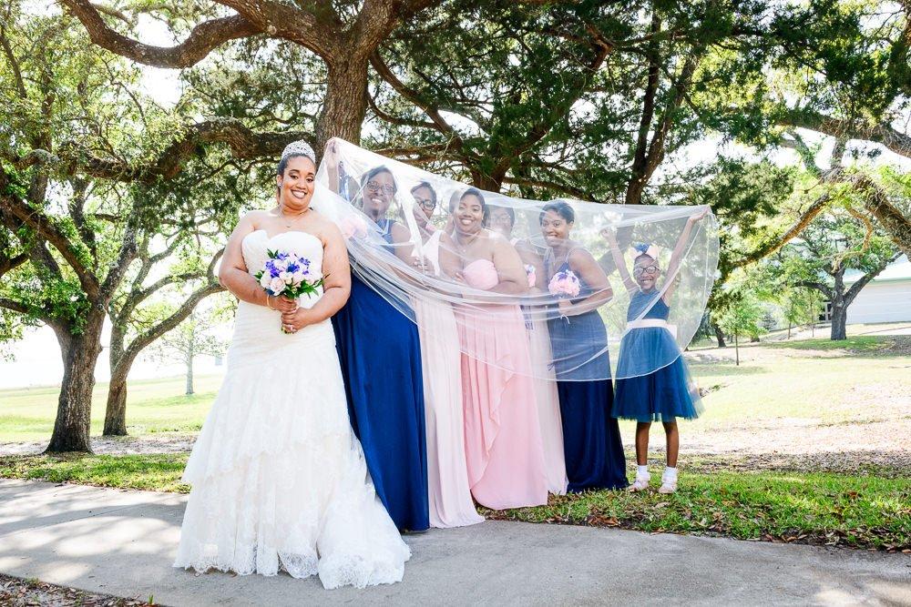 Bride with Bridesmaids under her veil, The Soundside Club, Elegant Ballroom Wedding, Lazzat Photography, Florida Wedding Photography