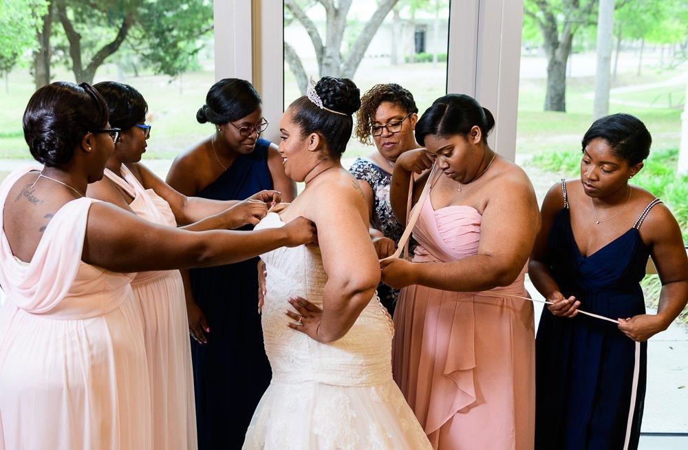 Bridesmaids lacing up Bride's dress, Blue and Pink Wedding, The Soundside Club, Elegant Ballroom Wedding, Lazzat Photography, Florida Wedding Photography