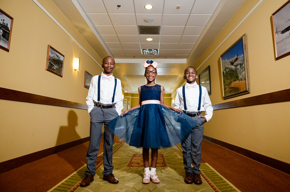 Flower girl and Ring bearers in the hallway, Blue and Pink Wedding, The Soundside Club, Elegant Ballroom Wedding, Lazzat Photography, Florida Wedding Photography