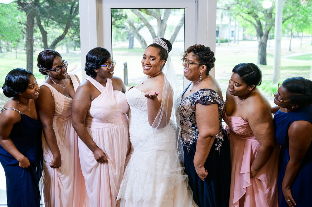 Bride showing off for her mom and bridesmaids, Blue and Pink Wedding, The Soundside Club, Elegant Ballroom Wedding, Lazzat Photography, Florida Wedding Photography