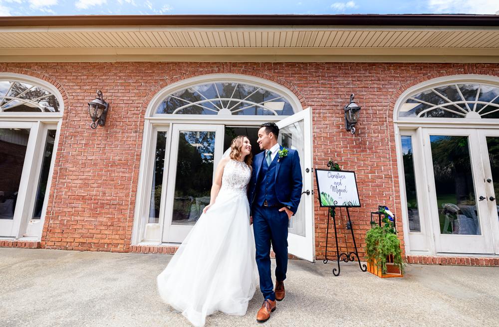 Bride and Groom smiling at each other outside of venue, The Garden Center, Pensacola Garden Wedding, Lazzat Photography, Florida wedding photographer photography