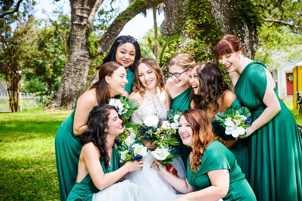 Bridesmaids around the Bride, green bridesmaid dress, blue and green wedding, The Garden Center, Pensacola Garden Wedding, Lazzat Photography, Florida wedding photographer photography