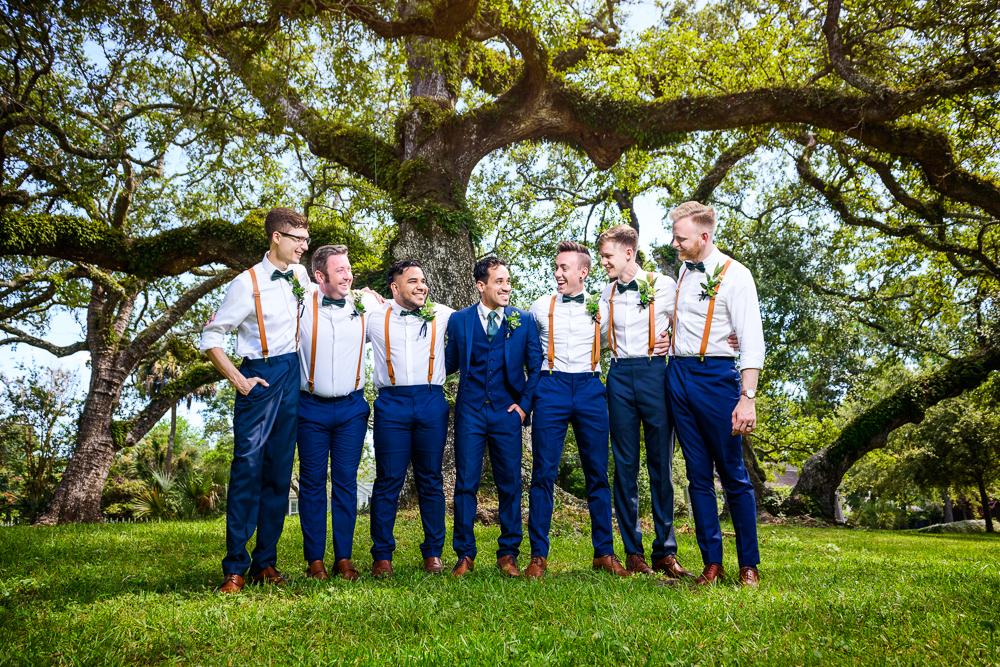 Groom and Groomsmen smiling, blue and green wedding, The Garden Center, Pensacola Garden Wedding, Lazzat Photography, Florida wedding photographer photography