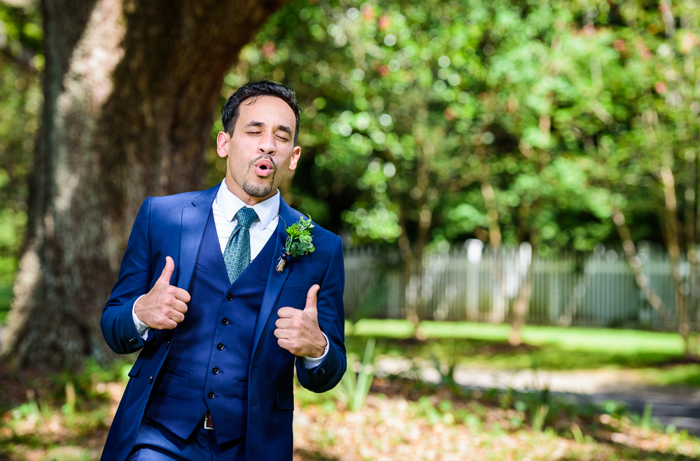 Groom giving thumbs up, blue and green wedding, The Garden Center, Pensacola Garden Wedding, Lazzat Photography, Florida wedding photographer photography