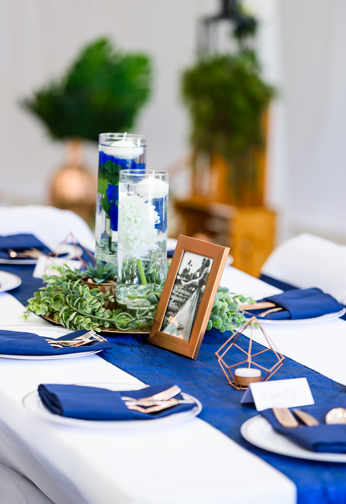 Floating candles, greenery and geometric candle holder centerpiece, blue and green wedding, The Garden Center, Pensacola Garden Wedding, Lazzat Photography, Florida wedding photographer photography