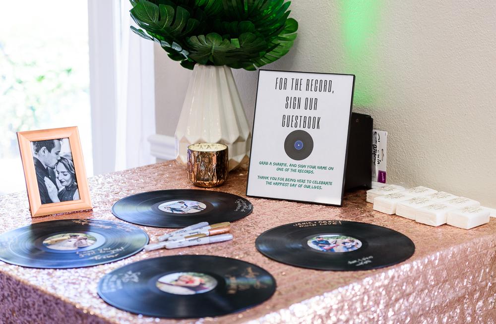 Vinyl record guest book with sign, The Garden Center, Pensacola Garden Wedding, Lazzat Photography, Florida wedding photographer photography