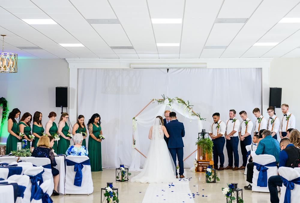 Praying during the ceremony, The Garden Center, Pensacola Garden Wedding, Lazzat Photography, Florida wedding photographer photography