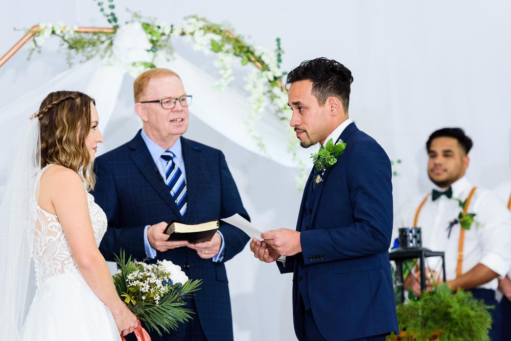 Groom reading his vows, The Garden Center, Pensacola Garden Wedding, Lazzat Photography, Florida wedding photographer photography