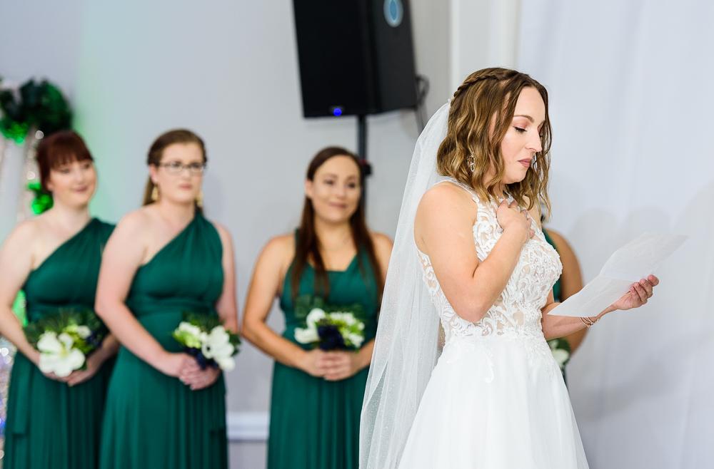 Bride reading her vows, The Garden Center, Pensacola Garden Wedding, Lazzat Photography, Florida wedding photographer photography