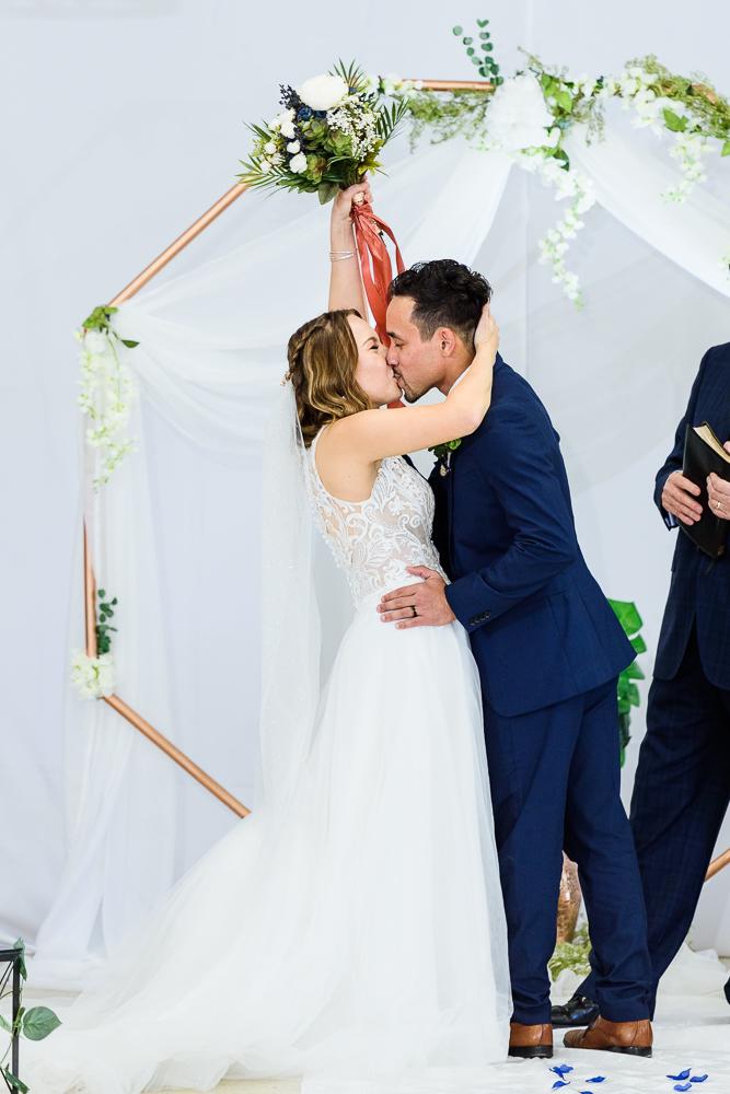 Bride and Groom's first kiss, The Garden Center, Pensacola Garden Wedding, Lazzat Photography, Florida wedding photographer photography