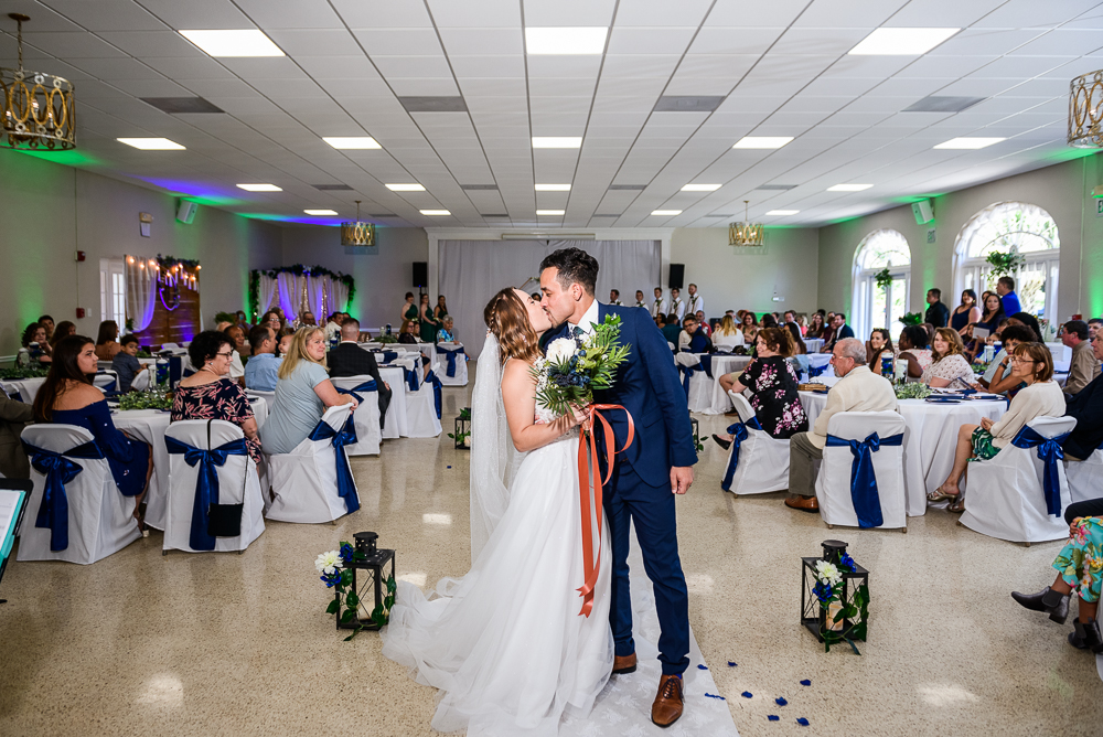 Bride and Groom kissing after the ceremony, The Garden Center, Pensacola Garden Wedding, Lazzat Photography, Florida wedding photographer photography
