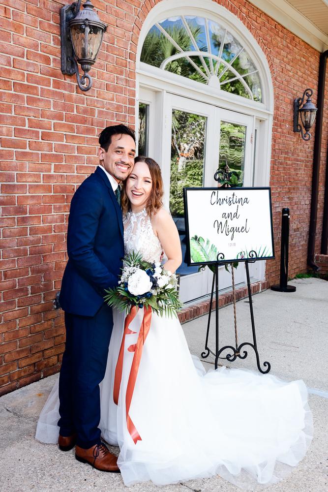 Bride and Groom outside their venue, The Garden Center, Pensacola Garden Wedding, Lazzat Photography, Florida wedding photographer photography