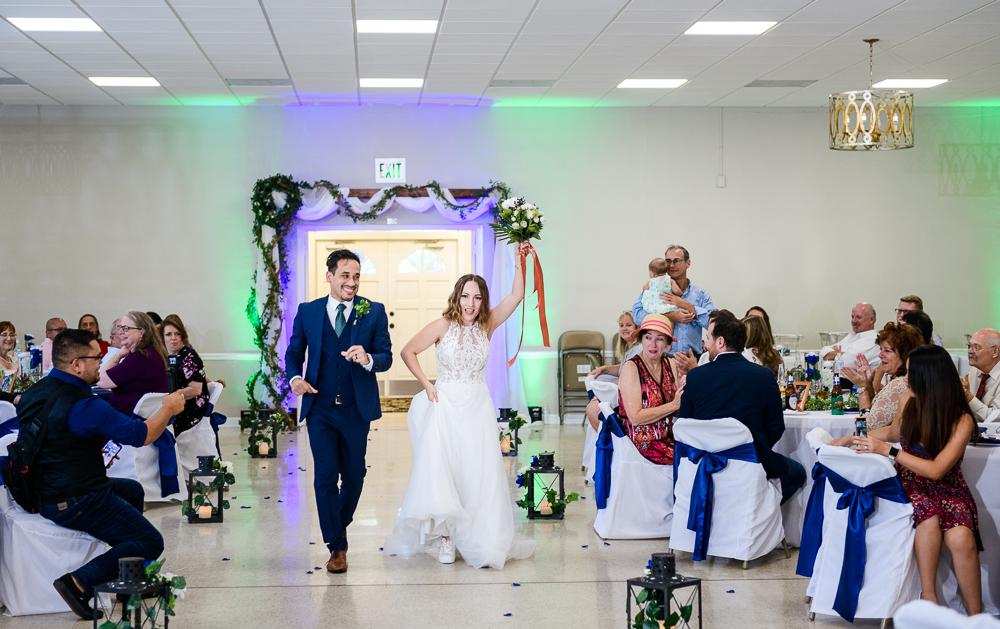 Bride and Groom dancing down the aisle, The Garden Center, Pensacola Garden Wedding, Lazzat Photography, Florida wedding photographer photography
