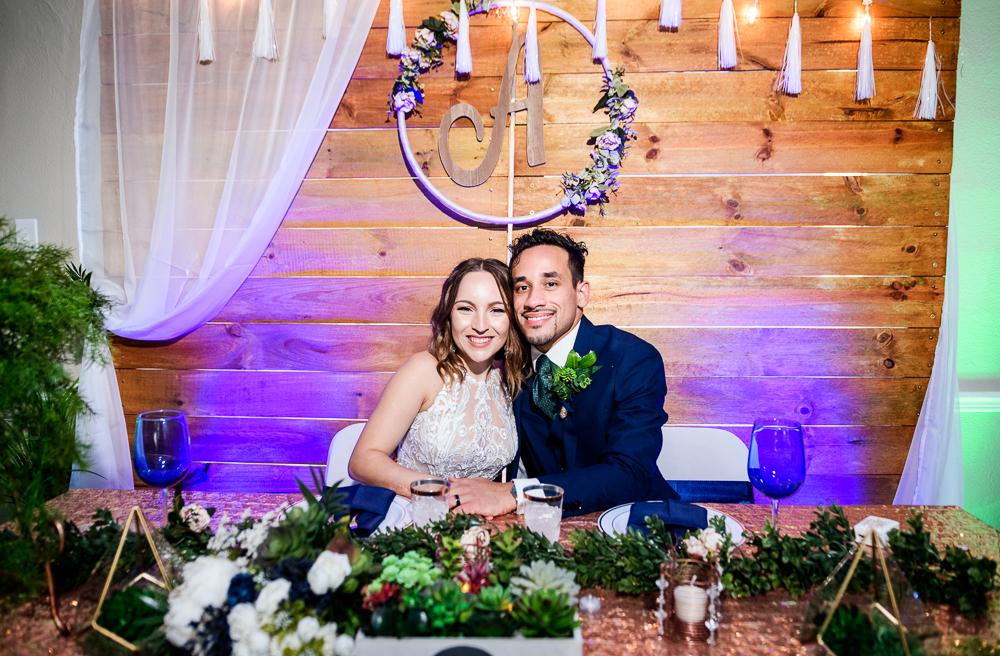 Bride and Groom at their sweetheart table, The Garden Center, Pensacola Garden Wedding, Lazzat Photography, Florida wedding photographer photography