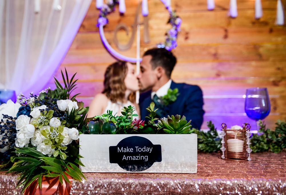 Bride and Groom kissing at their sweetheart table, The Garden Center, Pensacola Garden Wedding, Lazzat Photography, Florida wedding photographer photography