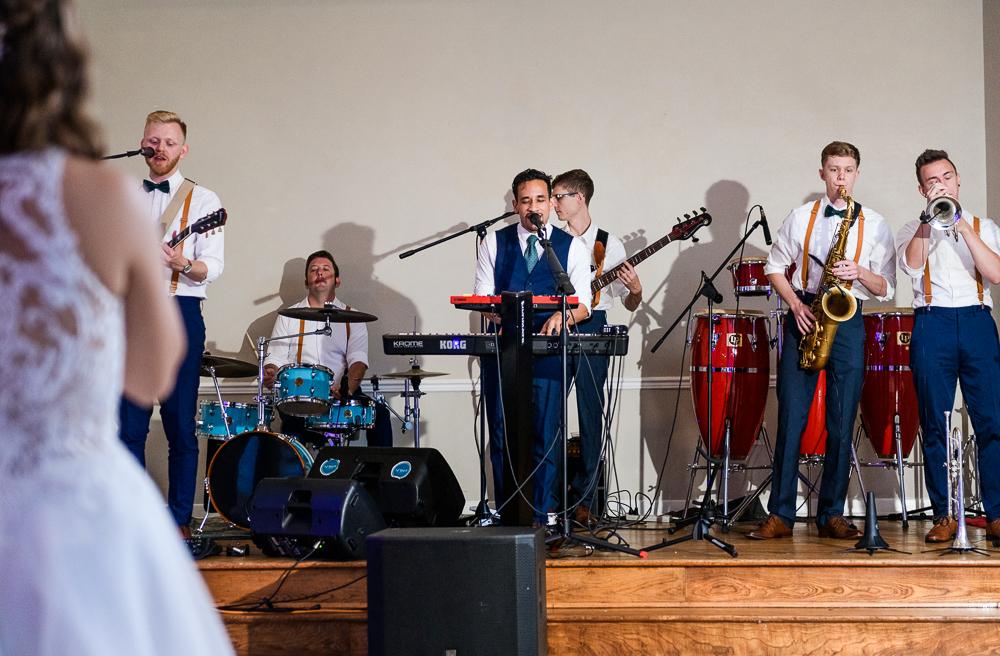 Groom singing to Bride, The Garden Center, Pensacola Garden Wedding, Lazzat Photography, Florida wedding photographer photography