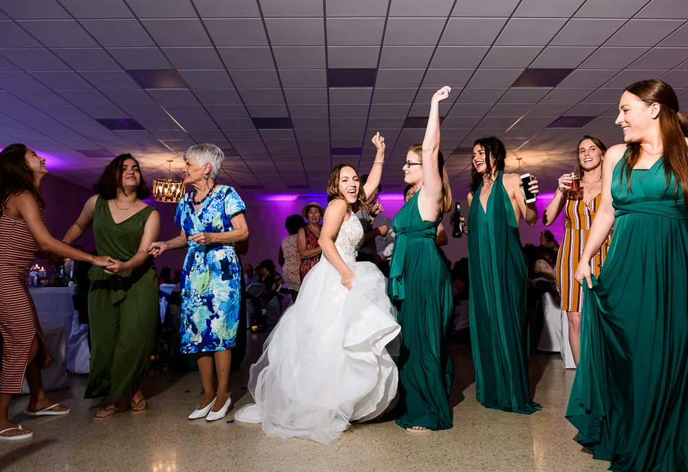 Bride dancing with bridesmaids, green bridesmaid dresses, The Garden Center, Pensacola Garden Wedding, Lazzat Photography, Florida wedding photographer photography