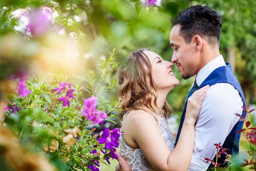 Bride and Groom smiling at each other in the garden, The Garden Center, Pensacola Garden Wedding, Lazzat Photography, Florida wedding photographer photography