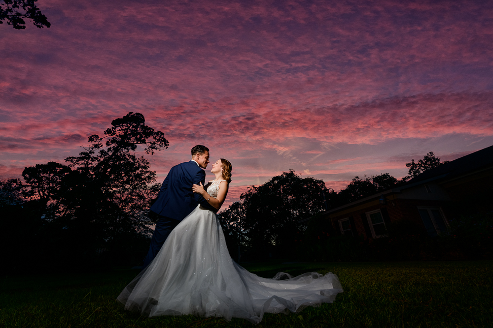 Bride and Groom smiling at each other during the sunset, The Garden Center, Pensacola Garden Wedding, Lazzat Photography, Florida wedding photographer photography