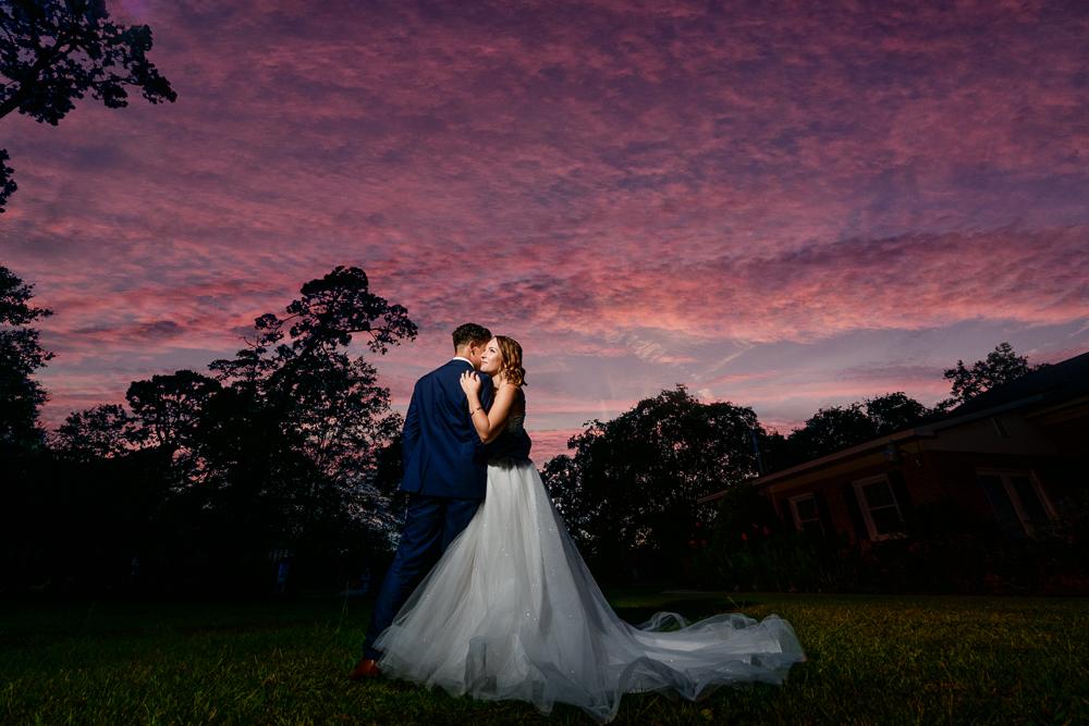 Bride and Groom hugging during the sunset, The Garden Center, Pensacola Garden Wedding, Lazzat Photography, Florida wedding photographer photography