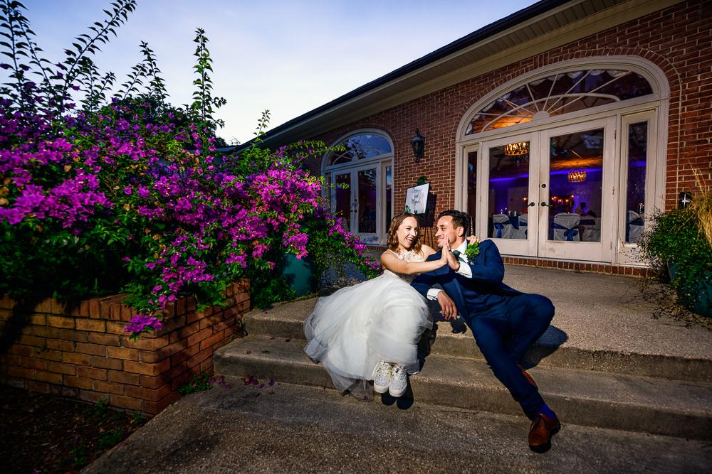 Bride and Groom high five outside venue, The Garden Center, Pensacola Garden Wedding, Lazzat Photography, Florida wedding photographer photography
