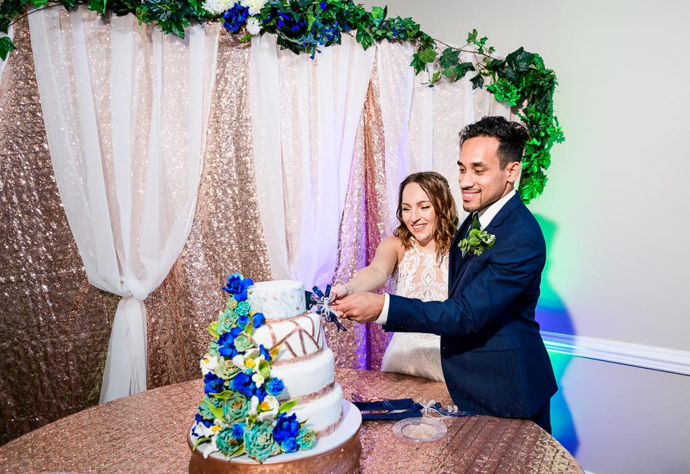 Bride and Groom cutting their wedding cake, The Garden Center, Pensacola Garden Wedding, Lazzat Photography, Florida wedding photographer photography