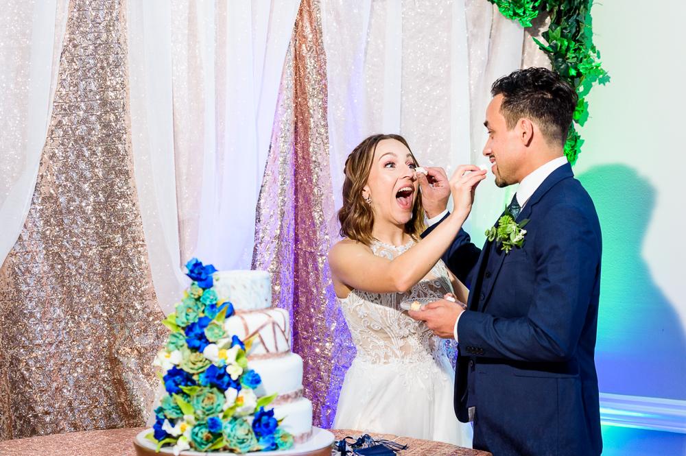 Bride and Groom feeding each other cake, The Garden Center, Pensacola Garden Wedding, Lazzat Photography, Florida wedding photographer photography