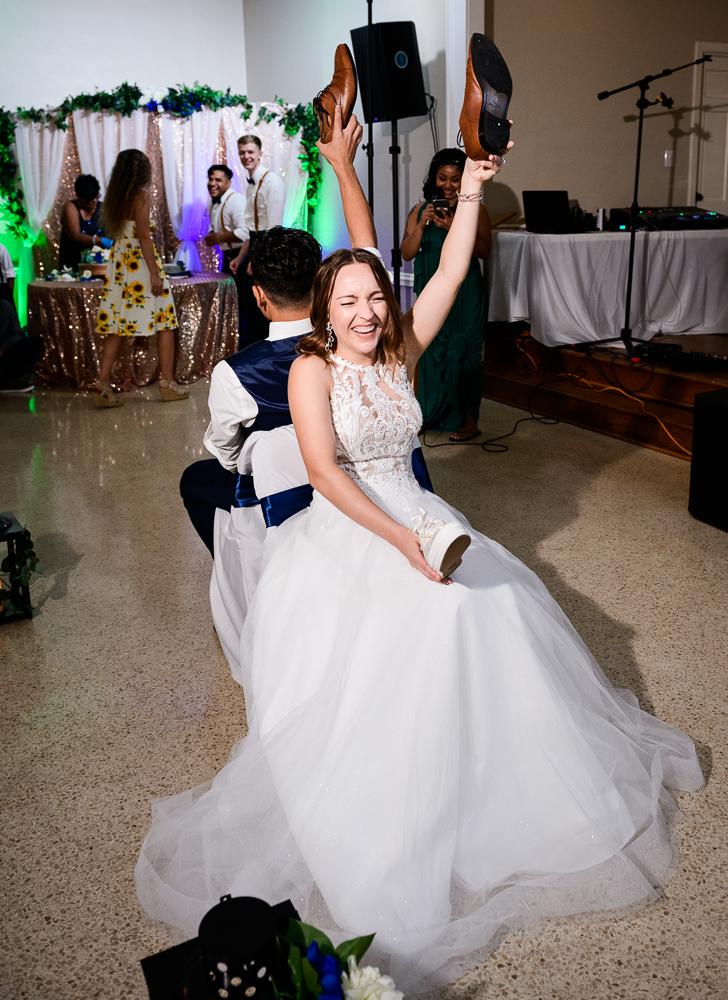 Bride during the shoe game, The Garden Center, Pensacola Garden Wedding, Lazzat Photography, Florida wedding photographer photography
