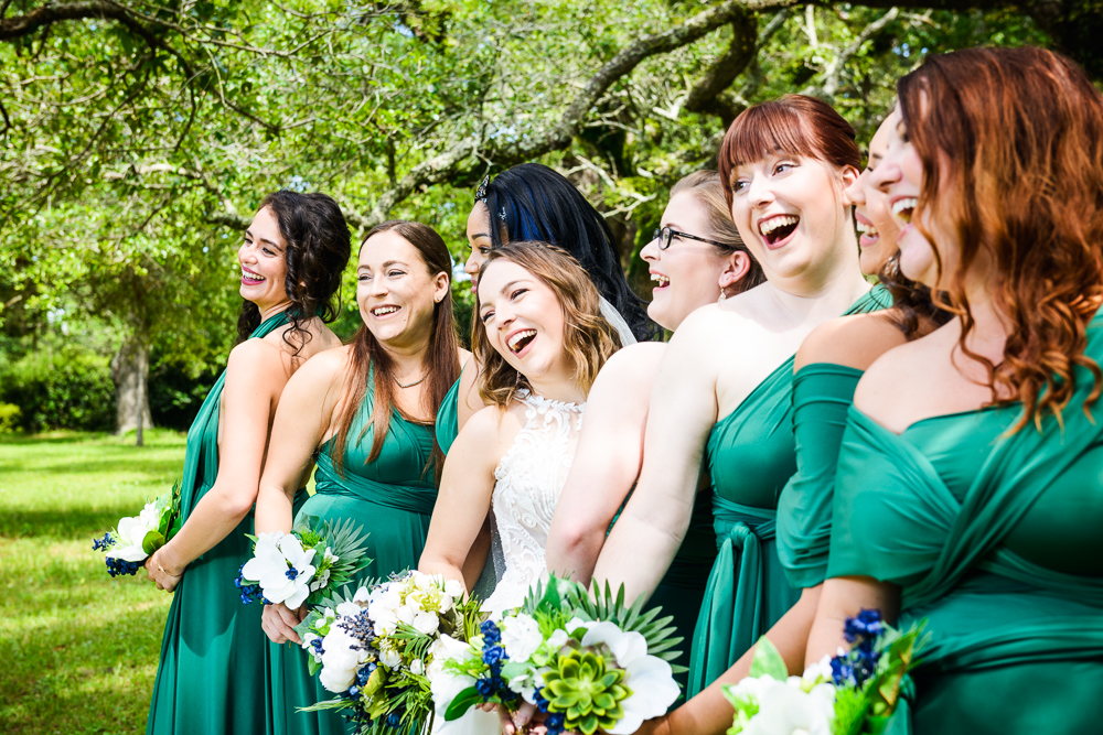 Bride and Bridesmaids laughing, green bridesmaid dress, blue and green wedding, The Garden Center, Pensacola Garden Wedding, Lazzat Photography, Florida wedding photographer photography