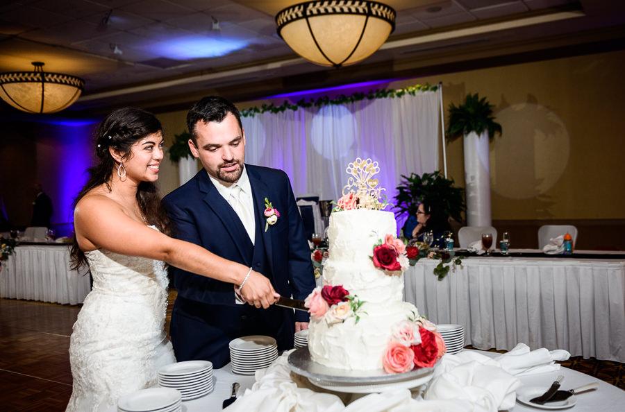 Bride and Groom cutting their wedding cake, Hilton Garden Inn Pensacola Airport, Pensacola Summer Wedding, Lazzat Photography
