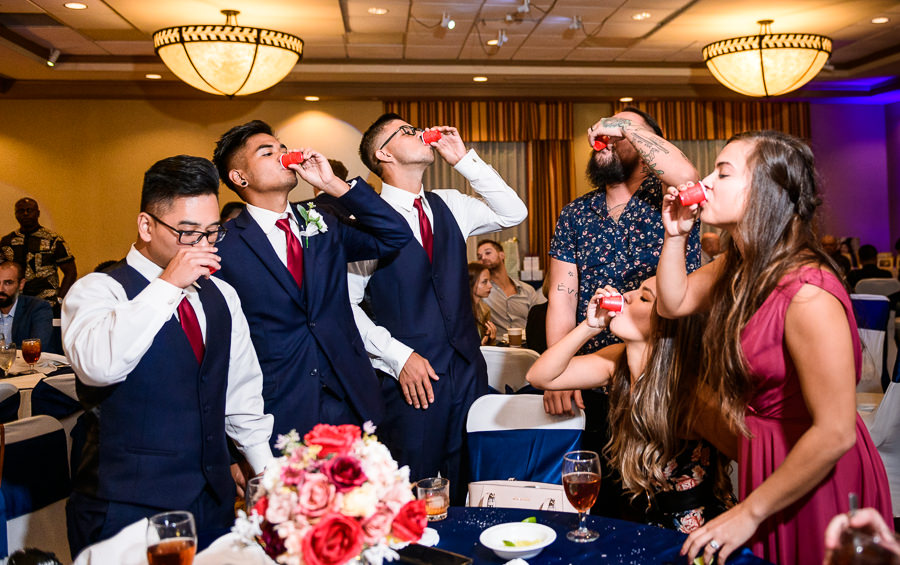 Bridesmaids and Groomsmen taking shots, Hilton Garden Inn Pensacola Airport, Pensacola Summer Wedding, Lazzat Photography