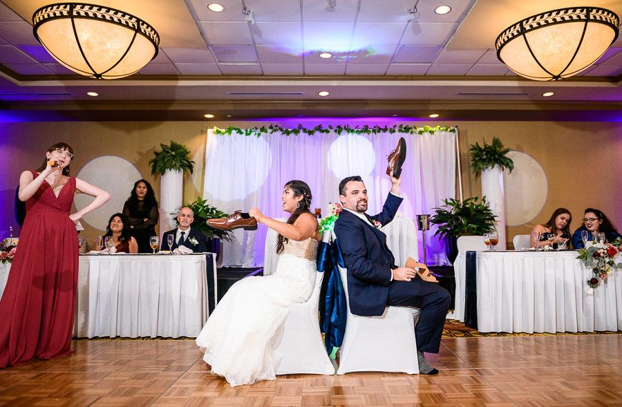 Bride and Groom playing the shoe game, Hilton Garden Inn Pensacola Airport, Pensacola Summer Wedding, Lazzat Photography